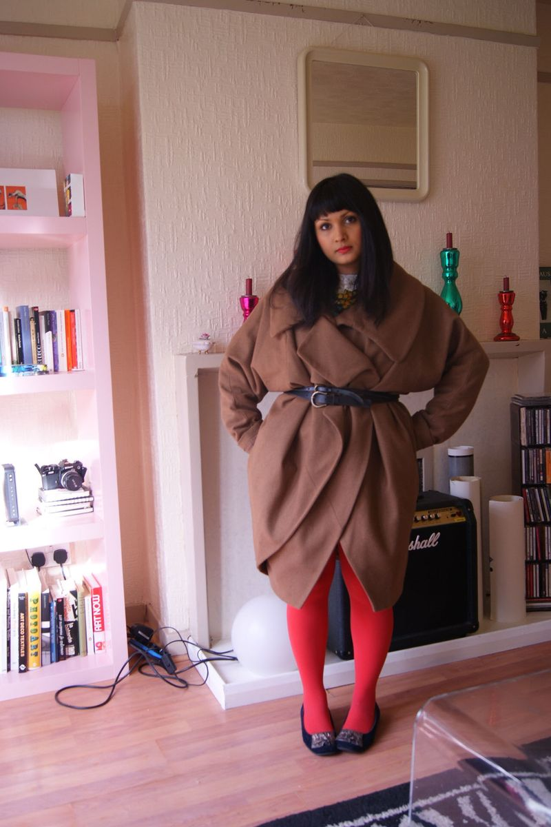 Brown coat red tights
