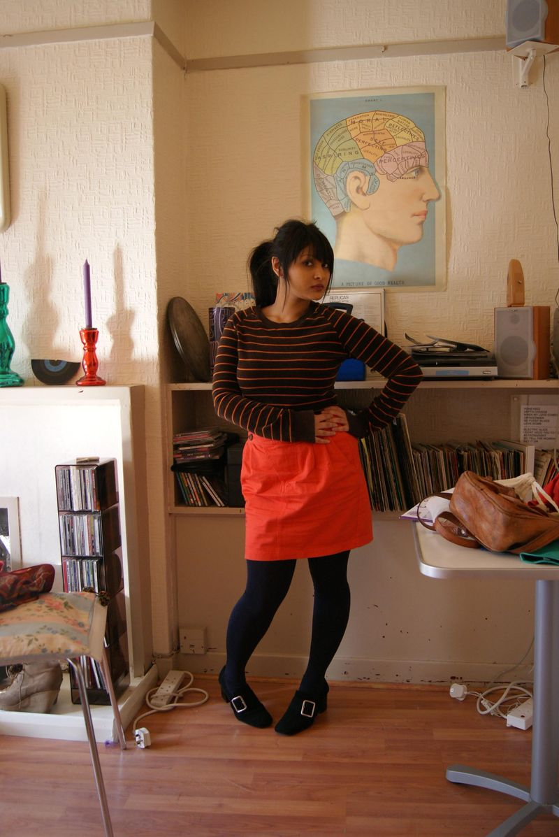 Velour top and orange skirt